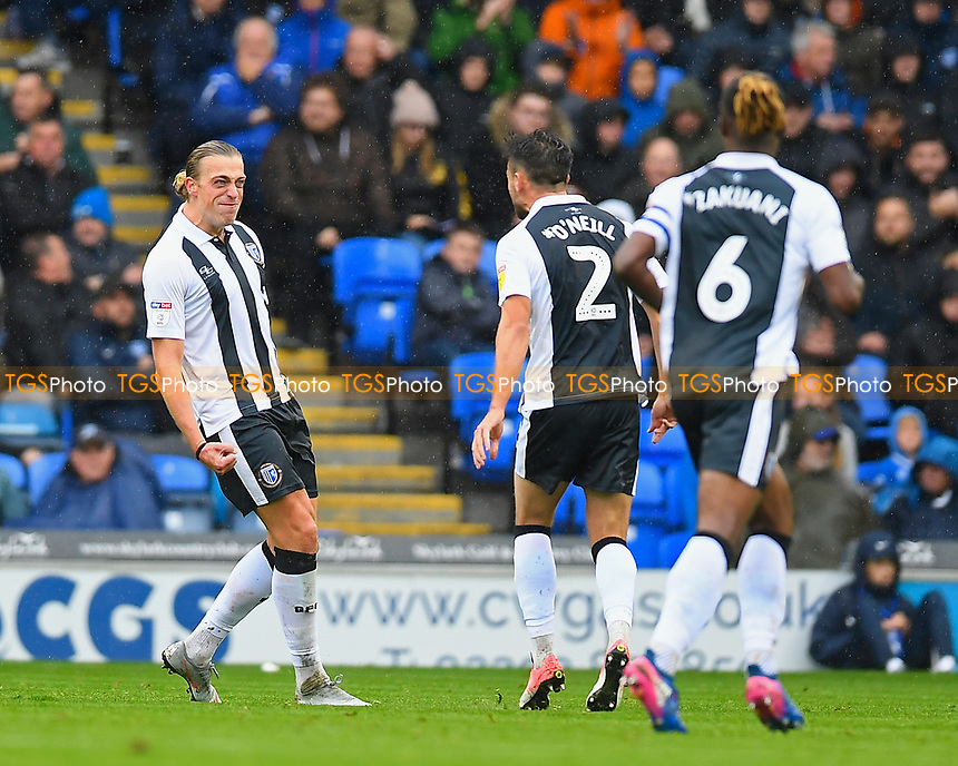 Tom Eaves of Gillingham left celebrates scoring the first goal with Luke O'Neill and Gabriel Zakuani of Gillinghami during Portsmouth vs Gillingham, Sky Bet EFL League 1 Football at Fratton Park on 6th October 2018