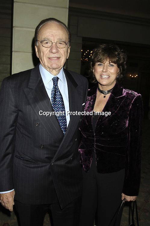 Rupert Murdoch and Kathy Williams ..at the Center for Communications Luncheon honoring Richard Parsons on October 20, 2005 at The Pierre Hotel. ..Photo by Robin Platzer, Twin Images