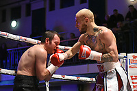 Jerome Campbell (red/white shorts) defeats Luke Fash during a Boxing Show at York Hall on 3rd March 2018