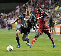 Philadelphia Union defender Chris Albright (3) and Chicago Fire forward Dominic Oduro (8) battle for the ball.  The Chicago Fire defeated the Philadelphia Union 1-0 at Toyota Park in Bridgeview, IL on March 24, 2012.
