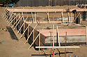 Wood is used to create foundation forms that  guide the pouring of concrete for a residential house foundation.