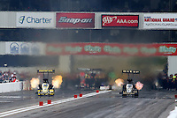 Sep 28, 2013; Madison, IL, USA; NHRA top fuel dragster driver Khalid Albalooshi (right) races alongside Morgan Lucas during qualifying for the Midwest Nationals at Gateway Motorsports Park. Mandatory Credit: Mark J. Rebilas-