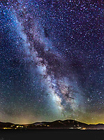 The Milky Way over Mount Pluto and the Northstar Resort taken from Martis Valley, near Truckee, California.  The lights of Kings Beach and Tahoe City on the north shore of Lake Tahoe shine on the horizon on the left and right of the frame.