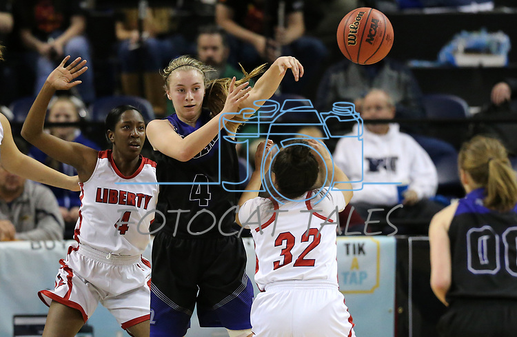 McQueen's Kendra McAninch passes around Liberty defenders Robin Walker, left, and Tedra Tovia during the NIAA state basketball tournament in Reno, Nev., on Thursday, Feb. 22, 2018. Liberty defeated McQueen 71-33. Cathleen Allison/Las Vegas Review-Journal