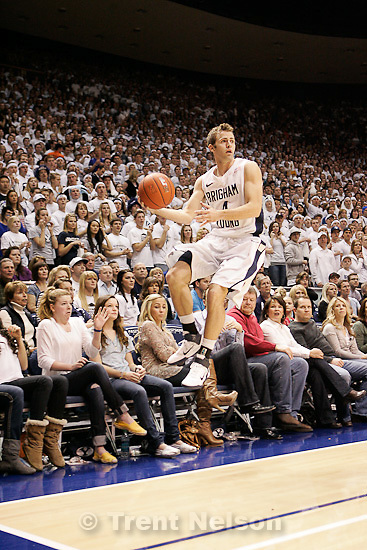 Trent Nelson  |  The Salt Lake Tribune.BYU's Jackson Emery saves the ball from going out of bounds in the first half at BYU vs. Utah, college basketball in Provo, Utah, Saturday, February 12, 2011.