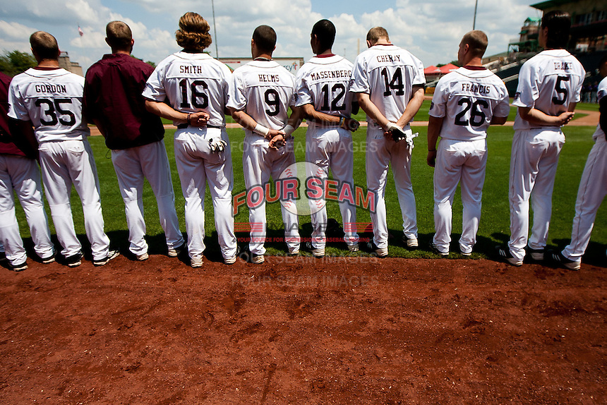 Members of the Missouri State Bears stand for the National Anthem during a game against the Evansville Purple Aces at Hammons Field on May 12, 2012 in Springfield, Missouri. (David Welker/Four Seam Images)