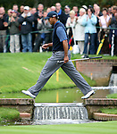 Tiger Woods of USA crosses the stream at the 13th.GOLF - WGC-American Express Championship - Sat 30 Sep 2006 - The Grove - Chandlers Cross - Hertfordshire. .(C) CameraSport.43 Linden Ave. Countesthorpe. Leicester. England. .LE8 5PG.Tel: +44 (0) 116 277 4147.admin@camerasport.com.www.camerasport.com