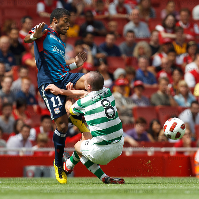 Scott Brown makes another hairy tackle, this time on Michel Bastos