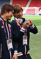Hampden Park, Glasgow match venue for Football at London 2012...Japanese players leaving the pitch after inspecting it........