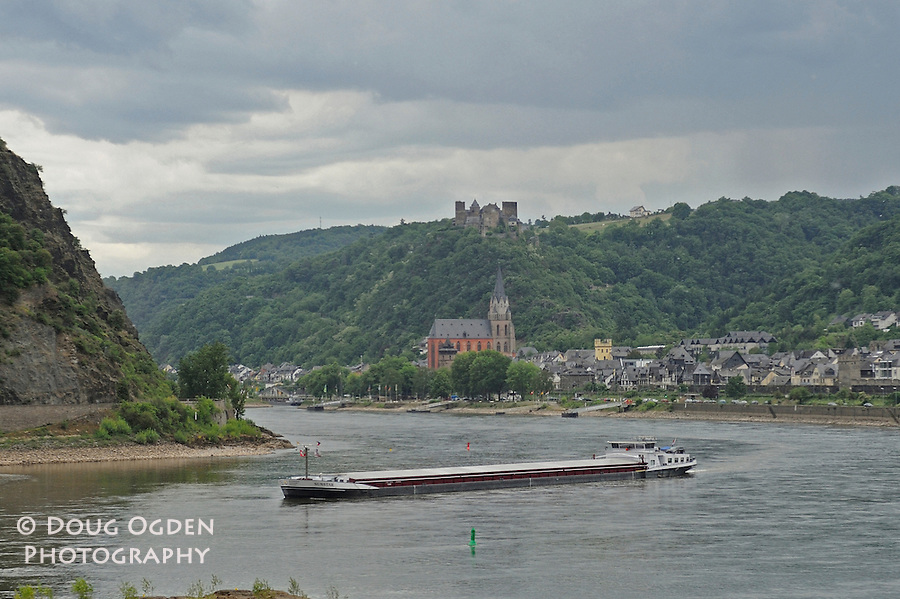 A cargo ship in the Middle Rhine river,  Oberwessel, Schonberg, Germany