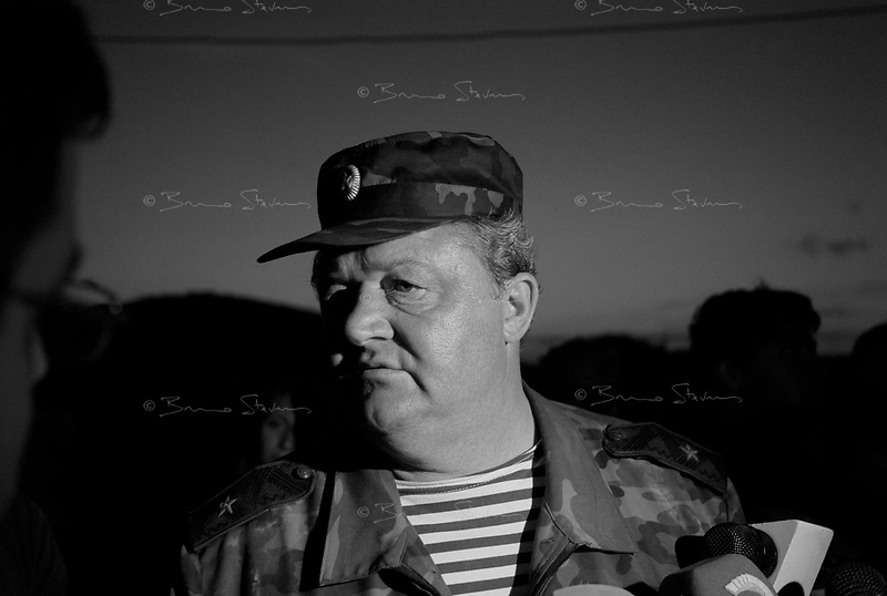 Goeti junction, Georgia, August 15 2008.General Nicolai Borissov is in charge of the Russian military operation in Georgia; he shows up unexpetedly in Goeti junction, a mere 38km from the Georgian capital Tbilissi; he came to inspect 2 armoured battalions that took position there. He is surrounded by curious journalists, and...incredulous Georgian interior security forces (SOD).