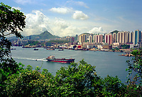 Hong Kong, China, 2005 file photo -<br /> a  cargo ship passe in front of Hong Kong skyline.