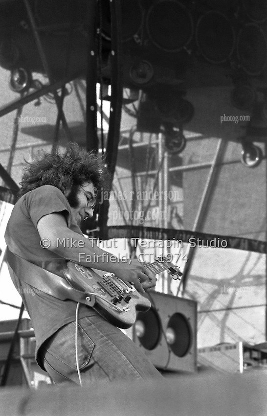 Jerry Garcia singing and playing Guitar with The Grateful Dead at Dillon Stadium in Hartford CT on 31 July 1974. Close in sidelong shot. Photo by Michael Thut, Fairfield CT.