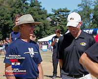 Mizzou head track and field coach Brett Halter and former SEMO standout, University of Kansas and Nebraska coach and current Blue Valley High School Track and Field Coach Rick Attig share a laugh at the 2013 Forest Park Cross Country Festival, Saturday, September 14, in St. Louis, MO.