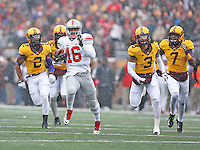 Ohio State Buckeyes quarterback J.T. Barrett (16) leaves the Gophers behind as he scores his team's first TD of the day at TCF Bank Stadium on November 15, 2014. (Chris Russell/Dispatch Photo)