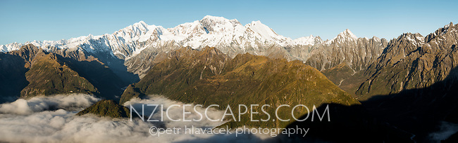 Afternoon light over Southern Alps with highest peaks Aoraki Mount Cook, Mount Tasman, La Perouse and Balfour Range. Mt. Copland on right, Westland Tai Poutini National Park, UNESCO World Heritage Area, West Coast, New Zealand, NZ