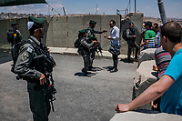 Palestinians are refused to cross the Qalandia check point of the separation barrier between Israel and the West Bank at on June 10, 2016 in West Bank. <br /> Photo Daniel Berehulak for the New York Times