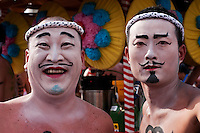 Nagamochi dancers, with elaborate face paint, wait for their turn during the Onbashira Festival in Shimosuwa, Japan.