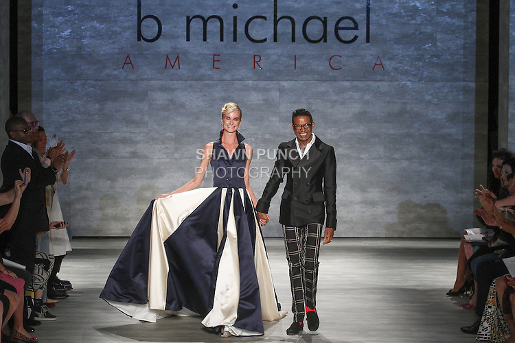 Fashion designer b michael walks runway with model for the close of his b michael AMERICA Couture Spring 2015 collection fashion show, during Mercedes-Benz Fashion Week Spring 2015 in New York City.