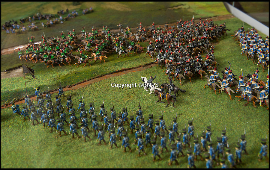 BNPS.co.uk (01202 558833)<br /> Pic: PhilYeomans/BNPS<br /> <br /> Von Blucher and his Prussians arriving late in the afternoon.<br /> <br /> Historic battle brought back to life...<br /> <br /> A stunning diorama of the battle of Waterloo has been restored to its former glory after a painstaking cleaning operation to remove nearly 50 years of dust.<br /> <br /> The sweeping panorama contain's 21,500 figures and nearly 10,000 horses, each of which has been meticulously cleaned by hand over the last five months by husband and wife team Kelvin and Mary Thatcher from Norfolk.<br /> <br /> The pristine model has now gone back on display at the refurbished Royal Green jackets museum in Winchester.<br /> <br /> A sobering fact is that there were over twice as many casualties in the actual battle as there are figures on the diorama.