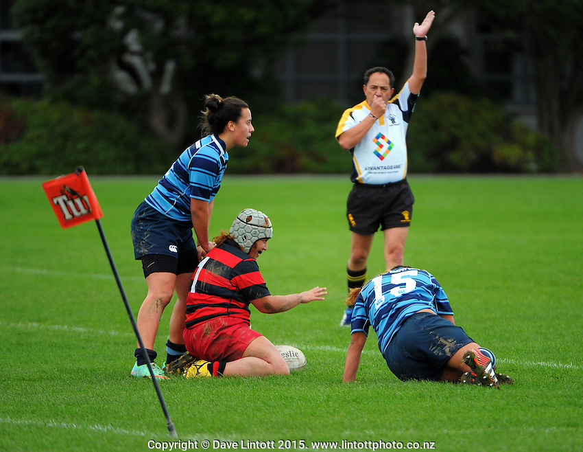 Action from the Wellington women's club rugby Fleurs Trophy match between Poneke (red and black hoops) and Johnsonville (blue) at Petone Recreation Ground , Wellington, New Zealand on Saturday, 16 May 2015. Photo: Dave Lintott / lintottphoto.co.nz