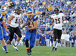 BROOKINGS, SD - SEPTEMBER 12:  Brady Mengarelli  #44 from South Dakota State scampers to the end zone past James Cowser #53 and Josh Thomton #25 from Southern Utah in the first half of their game Saturday night in Brookings. (Photo by Dave Eggen/Inertia)