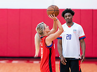 HOUSTON, TX - FEBRUARY 1: Danuel House of the Houston Rockets gives Julie Ertz #8 of the United States a few pointers at Houston Rockets Training Center on February 1, 2020 in Houston, Texas.