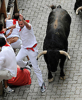 San Fermin, July 2012. Pamplona : Participants run with fighting bulls during a  San Fermin bull run in Pamplona on July 11, 2012. On each day of the San Fermin festival six bulls are released at 8:00 a.m. (0600 GMT) to run from their corral through the narrow, cobbled streets of the old navarre town over an 850-meter (yard) course. Ahead of them are the runners, who try to stay close to the bulls without falling over or being gored. Photo: Ander Gillenea.