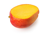 Closeup of a sliced ripe red Kent mango tropical fruit with juicy yellow flesh isolated on white studio background