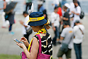A woman plays ''Pokemon Go'' on her smartphone on one of the hottest days of the summer at Pokemon GO PARK in Yokohama Minatomirai on August 9, 2017, Yokohama, Japan. Hundreds of Pokemon GO app fans gathered at the special Pokemon GO PARK, a 2km area including special PokeStops and PokemonGyms, to collect characters. Minatomirai holds an annual Pokemon event including a parade of 1500 Pikachu through the area and this year has added Pokemon GO attractions. Pokemon GO PARK is open from August 9 to 15. (Photo by Rodrigo Reyes Marin/AFLO)