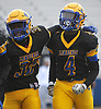 Jordan Alexander #4 of Lawrence, right, gets congratulated by Aaron Degrafenreid #32 after making an interception with 38 seconds remaining to seal a win over Wantagh in the Nassau County Conference III varsity football final at Hofstra University on Saturday, Nov. 18, 2017.