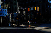 A man walks a street during a sunny day in the Neighborhood of Exchange Place in New Jersey, 12/15/2015 Photo by VIEWpress