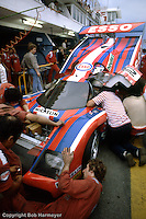 LE MANS, FRANCE: The WM P82 Peugeot of Alain Couderc, Guy Fréquelin and Roger Dorchy is serviced in the pit lane before practice for the 24 Hours of Le Mans on June 20, 1982, at Circuit de la Sarthe in Le Mans, France.