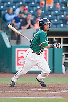 Yefri Perez (12) of the Greensboro Grasshoppers follows through on his swing against the Hagerstown Suns at NewBridge Bank Park on May 20, 2014 in Greensboro, North Carolina.  The Grasshoppers defeated the Suns 5-4. (Brian Westerholt/Four Seam Images)