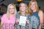 PROGRAMME: Kate Brosnan, Frances Clifford and Niamh Brosnan, picking a winner at the fundraising race night to rtaise funds for Fenit Rowing Club, on Saturday evening in  The Tankard Bar & Restaurant, Kilfenora Fenit.