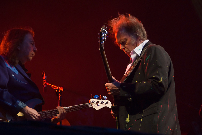 Neil Young [seen here with Rick Rosas] headlines the Hop Farm one day festival on 6 July 2008 in Kent, England.