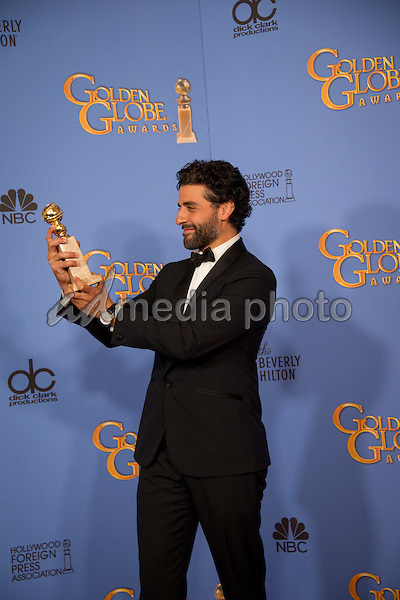 "After winning the category of BEST PERFORMANCE BY AN ACTOR IN A MINI-SERIES OR MOTION PICTURE MADE FOR TELEVISION for his role in ""Show Me a Hero,"" actor Oscar Isaac poses backstage in the press room with his Golden Globe Award at the 73rd Annual Golden Globe Awards at the Beverly Hilton in Beverly Hills, CA on Sunday, January 10, 2016. Photo Credit: HFPA/AdMedia"