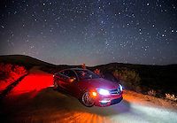 Aug. 22, 2014; BLACK CANYON CITY, AZ, USA; The Milky Way Galaxy and other stars are visible in the Arizona sky over a Mercedes Benz C63 AMG coupe in the desert near Black Canyon City, AZ. Mandatory Credit: Mark J. Rebilas