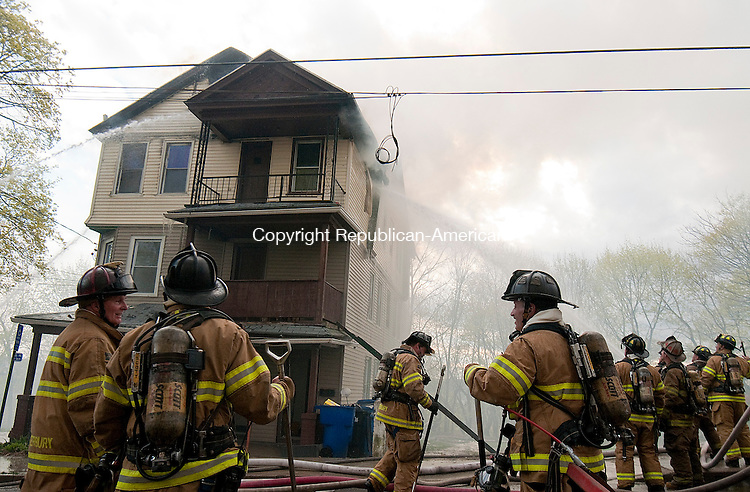 WATERBURY, CT--043015JS15- Waterbury firefighters battled a fire at a multifamily home at 69 Dikeman Street in Waterbury on Thursday. The only family living there was able to escape.  <br /> Jim Shannon Republican-American