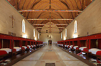 Salle des Povres or Room of the Poor, almost 50m long, with curtained beds for patients and a painted wooden ceiling with dragons' heads and caricatures of local people, in Les Hospices de Beaune, or Hotel-Dieu de Beaune, a charitable almshouse and hospital for the poor, built 1443-57 by Flemish architect Jacques Wiscrer, and founded by Nicolas Rolin, chancellor of Burgundy, and his wife Guigone de Salins, in Beaune, Cote d'Or, Burgundy, France. The furniture was restored in 1875 by Maurice Ourdou. The hospital was run by the nuns of the order of Les Soeurs Hospitalieres de Beaune, and remained a hospital until the 1970s. The building now houses the Musee de l'Histoire de la Medecine, or Museum of the History of Medicine, and is listed as a historic monument. Picture by Manuel Cohen