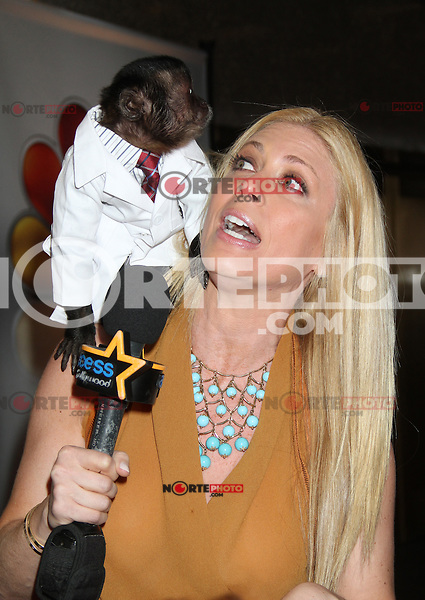 Crystal the Monkey jumps on the shoulder of a reporter at NBC's Upfront Presentation at Radio City Music Hall on May 14, 2012 in New York City. ©RW/MediaPunch Inc.