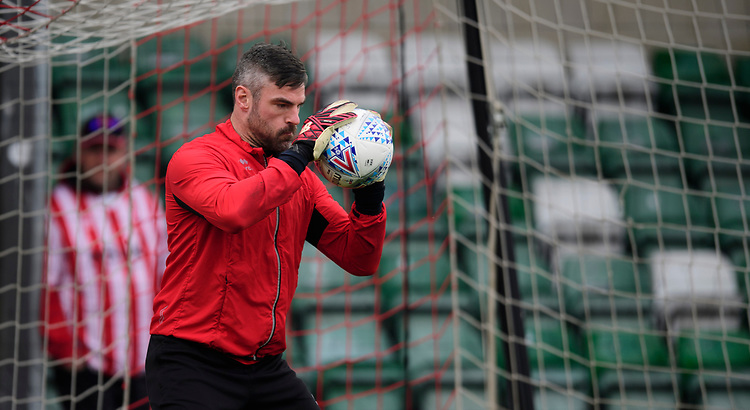 Lincoln City's Matt Gilks during the pre-match warm-up<br /> <br /> Photographer Chris Vaughan/CameraSport<br /> <br /> The EFL Sky Bet League Two - Lincoln City v Macclesfield Town - Saturday 30th March 2019 - Sincil Bank - Lincoln<br /> <br /> World Copyright © 2019 CameraSport. All rights reserved. 43 Linden Ave. Countesthorpe. Leicester. England. LE8 5PG - Tel: +44 (0) 116 277 4147 - admin@camerasport.com - www.camerasport.com