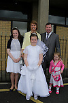 Hannah Newman, Katie Doloras Darren and Megan at first communion in Holy Family church.<br /> Picture www.newsfile.ie