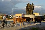 ALBANIA, Shkodra, farmer with cows infront of war memorial / ALBANIEN, Shkoder, Bauer mit Kuehen vor Denkmal aus dem Krieg