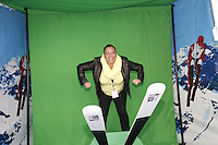 NEW YORK - OCT 29: Fan Zoe Baez poses on a ski jump photo booth. Olympic athletes participate in 100 Days to Sochi, a promotional event for the US Olympic Team, on Tuesday, October 29, 2013 in New York City. (Photo by Landon Nordeman)