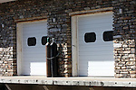 Unusual brick work on the exterior of a building with freight doors in Branson Missouri