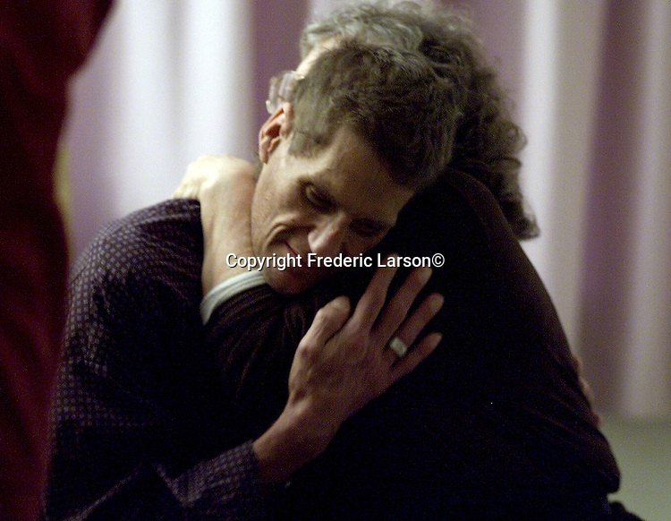 AIDS patient Richard Manning gives Chaplain Martha Jo Chalmers a hug after getting married by her on the SFGH grounds.
