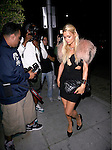 .May 3rd 2012    Thursday night .. .Paris Hilton at Mr. Chows in Beverly Hills wearing a black diamond V dress & a pink fur scarf jacket ...AbilityFilms@yahoo.com.805-427-3519.www.AbilityFilms.com.