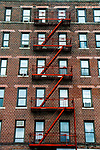 Flatbush, Brooklyn - December 10, 2016:  The fire escape of a large apartment building on Nostrand Avenue.  Photo Credit:  Diane Bezucha