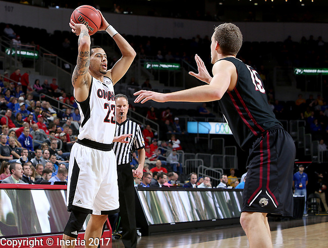 SIOUX FALLS, SD: MARCH 6: 	Marcus Tyus #23 from Omaha looks for a teammate around Matt O'Leary #15 from IUPUI during the Summit League Basketball Championship on March 6, 2017 at the Denny Sanford Premier Center in Sioux Falls, SD. (Photo by Dave Eggen/Inertia)